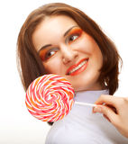 Pretty young woman holding lolly pop. Stock Photography