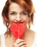 Pretty young woman holding lolly pop. Royalty Free Stock Image