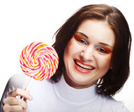 Pretty young woman holding lolly pop. Stock Photos