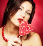 Pretty young woman holding lolly pop. Stock Images