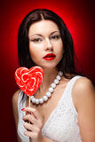 Pretty young woman holding lolly pop. Royalty Free Stock Photo
