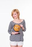 Pretty young woman holding old globe. White Royalty Free Stock Images
