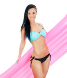 Pretty young woman holding pink inflatable mattress. Royalty Free Stock Photo
