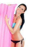 Pretty young woman holding pink inflatable mattress. Royalty Free Stock Images