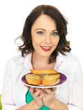 Pretty Young Woman Holding A Plate of Delicious Tasty Garlic Bread Stock Photo