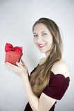 Pretty young woman holding red Valentines gift Stock Photo