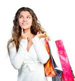 Pretty young woman holding shopping bags Royalty Free Stock Photos