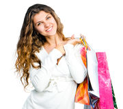 Pretty young woman holding shopping bags Royalty Free Stock Photo