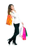 Pretty young woman holding shopping bags Stock Photography