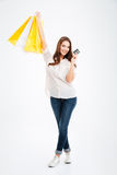 Pretty young woman holding shopping bags and bank card royalty free stock images