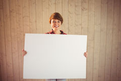 Pretty young woman holding sign Royalty Free Stock Photos