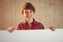 Pretty young woman holding sign Stock Photography
