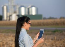 Farmer woman with tablet and silos Stock Photography