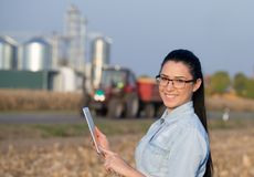 Farmer woman with tablet and silos Royalty Free Stock Image