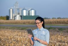 Farmer woman with tablet and silos Stock Image
