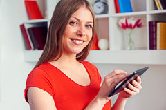 Pretty young woman holding the tablet pc Stock Photos