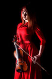 Pretty young woman holding a violin Stock Image