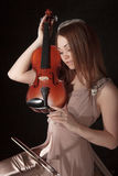 Pretty young woman holding a violin Royalty Free Stock Photos