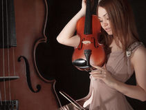Pretty young woman holding a violin Royalty Free Stock Image