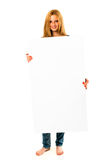 Pretty young woman holding a white banner. Portrait of a pretty young woman holding a white banner with lots of space for your text against a perfect white Stock Image