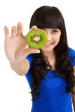 Pretty young woman holds kiwi Stock Photography