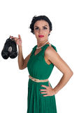 Pretty young woman holds shoes Royalty Free Stock Photography