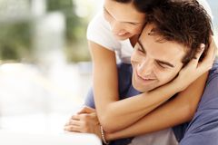 Pretty young woman hugging her boyfriend Royalty Free Stock Images