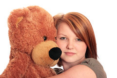 Pretty young woman hugging a Teddy Bear Stock Photos