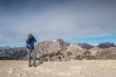 Pretty young woman in italien dolomites, south tyrol, italien alps, tre cime di lavaredo stock images