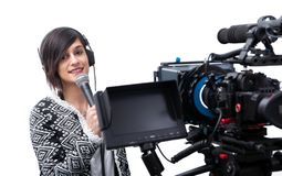 Pretty young woman  journalist with microphone and camera on white royalty free stock images