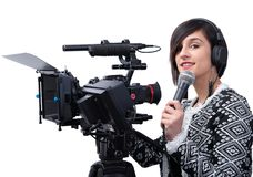 Pretty young woman  journalist with microphone in television studio on white stock image