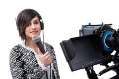 Pretty young woman  journalist presenting report in television studio on white stock photo