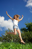 Pretty young woman jumping Royalty Free Stock Photos