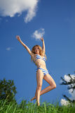 Pretty young woman jumping Stock Photo