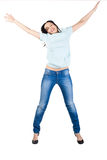 Pretty young woman jumping in air Royalty Free Stock Images