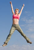 Pretty young woman is jumping outdoors Stock Photo