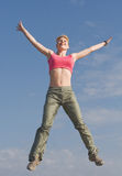Pretty young woman is jumping outdoors Royalty Free Stock Photos