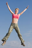 Pretty young woman is jumping outdoors Royalty Free Stock Photo