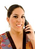 Pretty young woman in kimono busy talking on phone Royalty Free Stock Photo