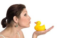 Pretty young woman kissing a rubber duck Stock Image