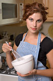 Pretty young woman in kitchen. Pretty young woman cooks dinner in her kitchen royalty free stock images