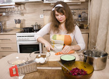 Pretty young woman on kitchen preparing dinner Royalty Free Stock Image