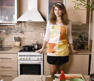 Pretty young woman on kitchen preparing dinner Royalty Free Stock Photo
