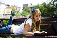 Pretty young woman with laptop stock photo