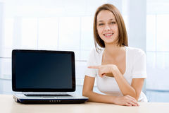 Pretty young woman and a laptop Royalty Free Stock Image