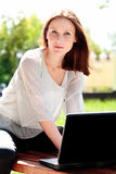 Pretty young woman with a laptop Royalty Free Stock Photo