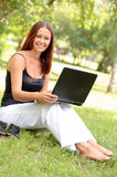 Pretty young woman with a laptop Royalty Free Stock Image