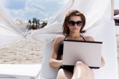 Pretty young woman with laptop Stock Photography