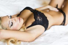 Pretty young woman laying on the bed Royalty Free Stock Photography