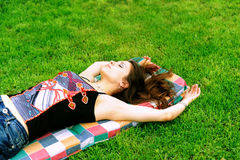 The pretty young woman laying on green grass Stock Photo